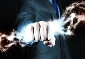 Close up of businessman hand holding lightning in fist.jpeg